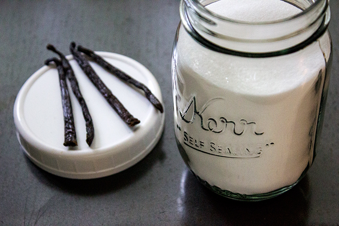 Cut Vanilla Beans and a Jar of Sugar